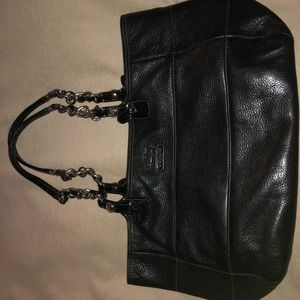 Black Coach purse with silver chain link on straps